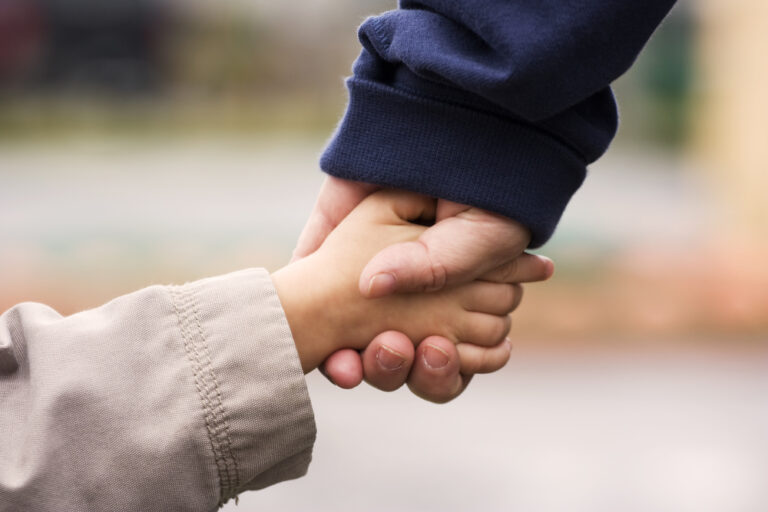 Mom and son hold hands