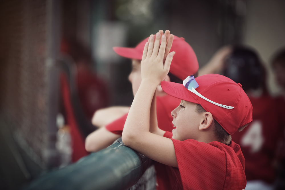 Young baseball player cheering