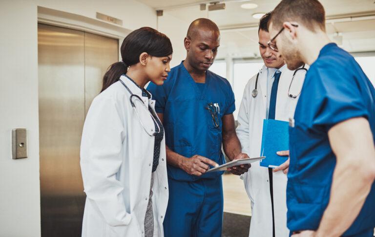 Doctors meeting in a hallway