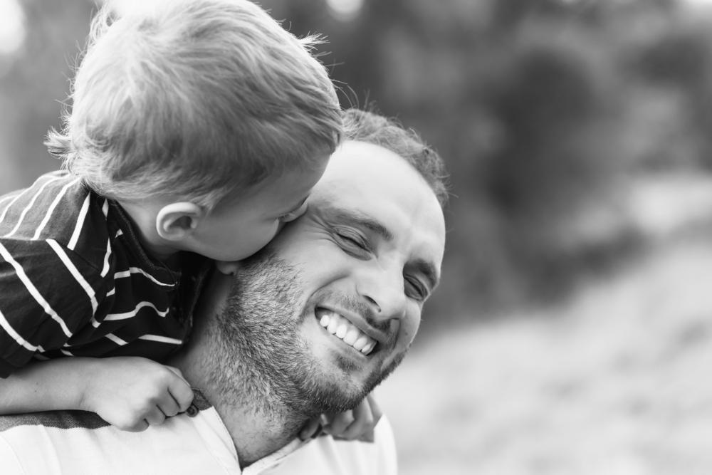 Child kissing dad