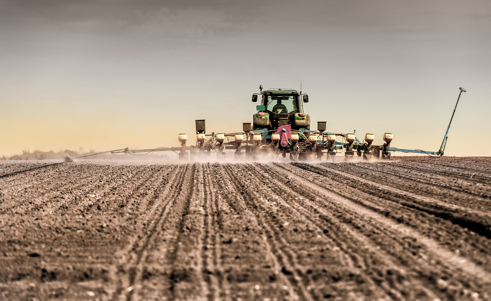 Combine planting seeds in farm field