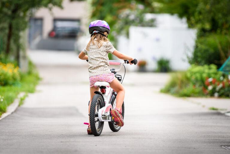 Little girl on bike in neighborhood