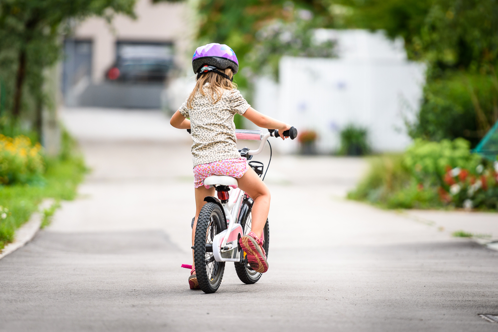 Little girl on bike in neighborhood