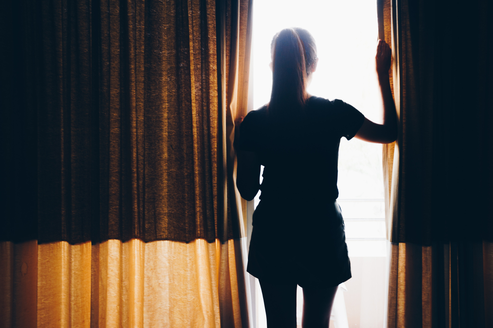 Woman looking out window silhouette