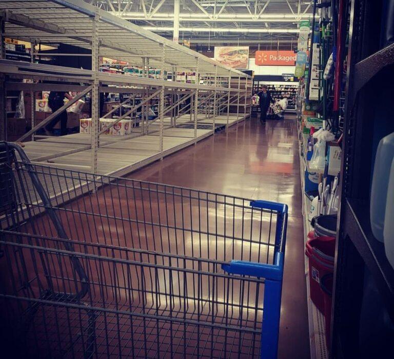 Walmart cart by empty aisle