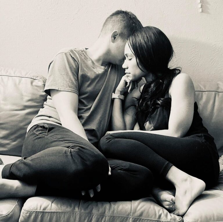 Husband and wife on couch black and white photo