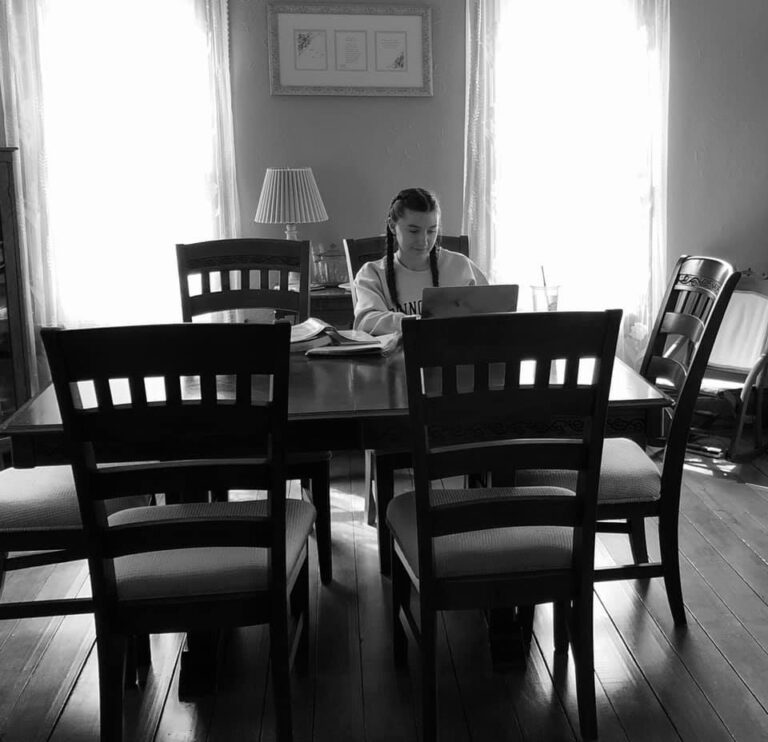 Teen at table with computer