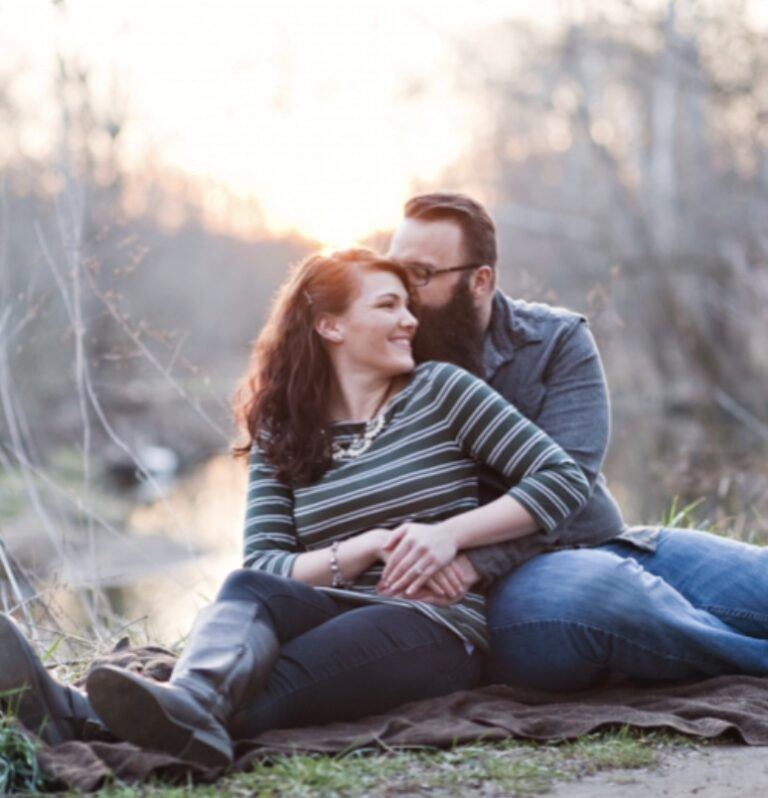 Husband holding wife, outdoor, color photo