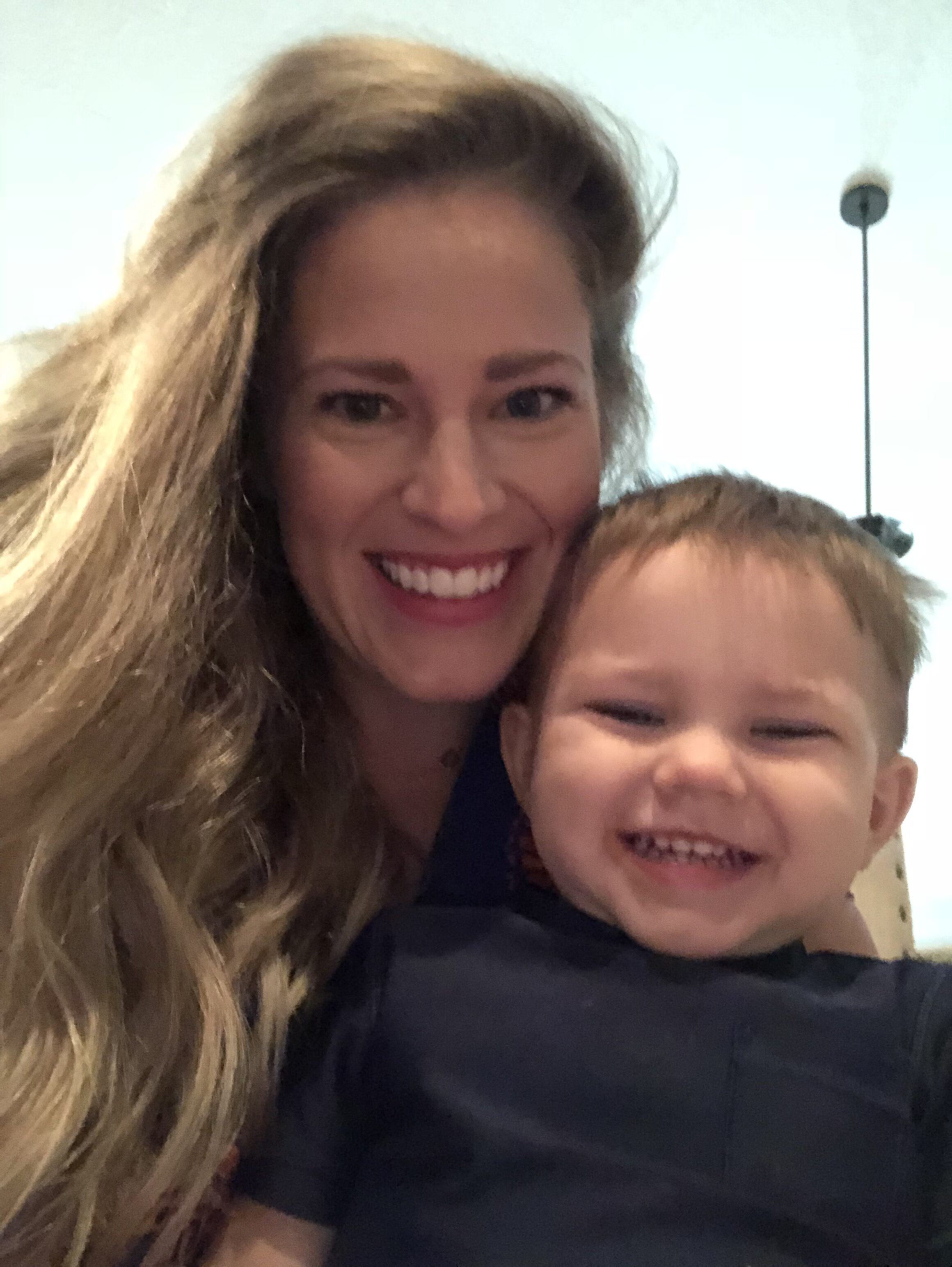 Mom and son smiling, color photo