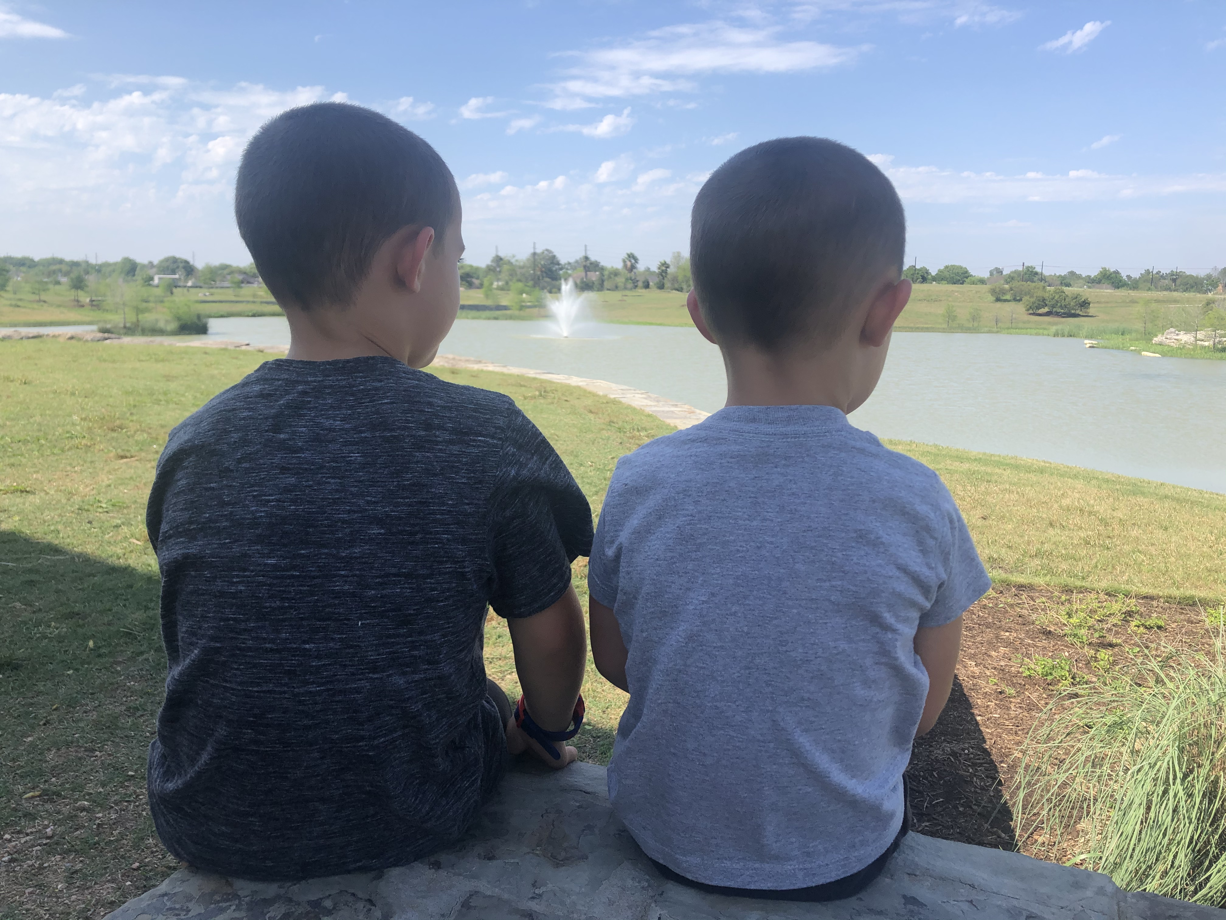 Brothers sitting together outside