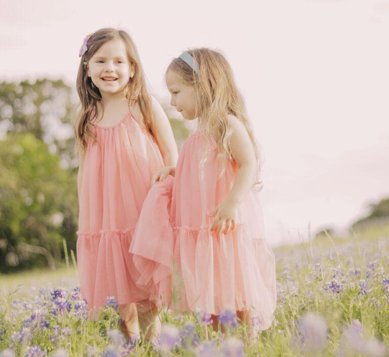 Two little girls in a field