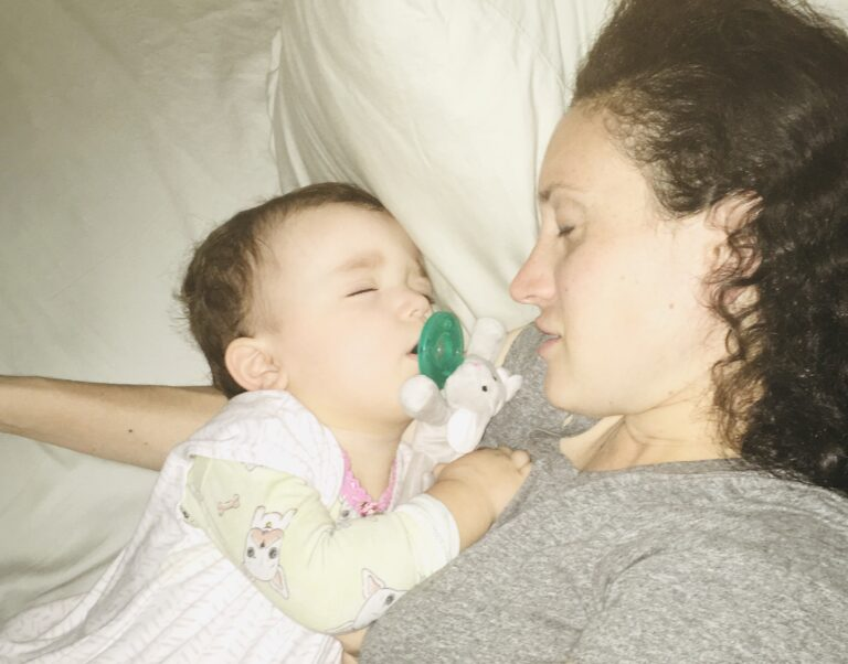 Mom with sleeping toddler