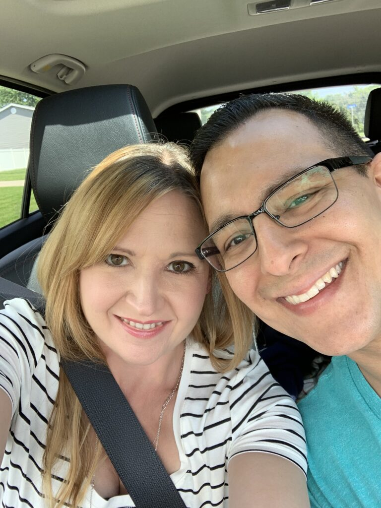 Husband and wife selfie in car, color photo