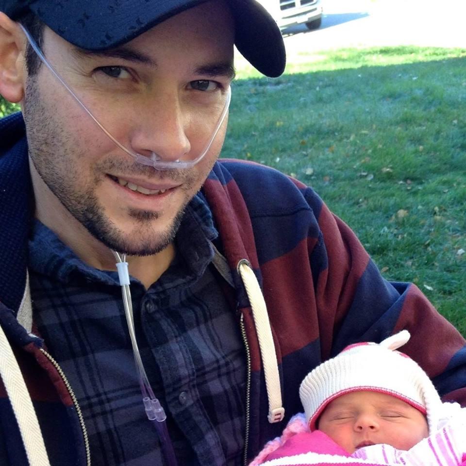 Phil Hastings with newborrn daughter