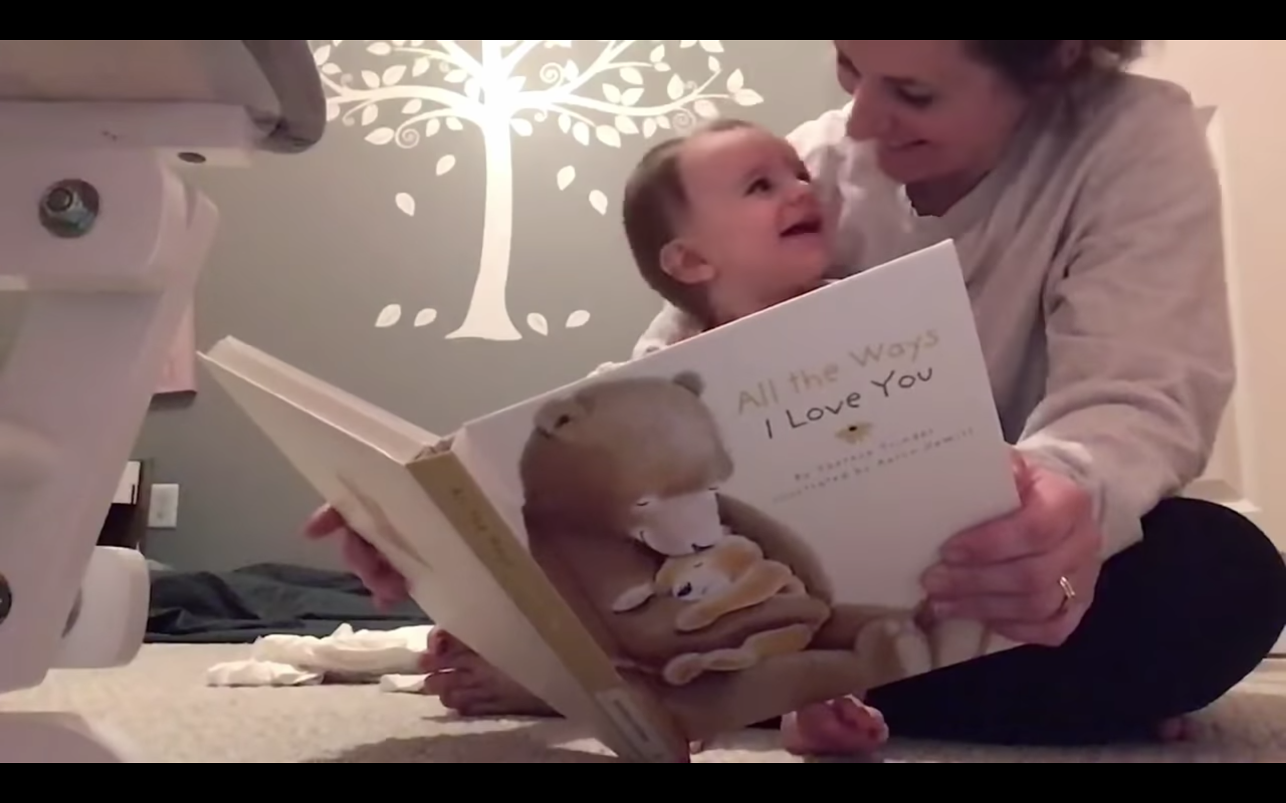 Mother reading a book to baby