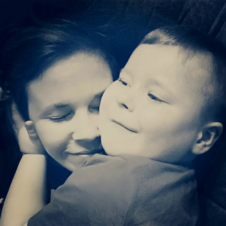 Little boy hugging mom, black-and-white photo