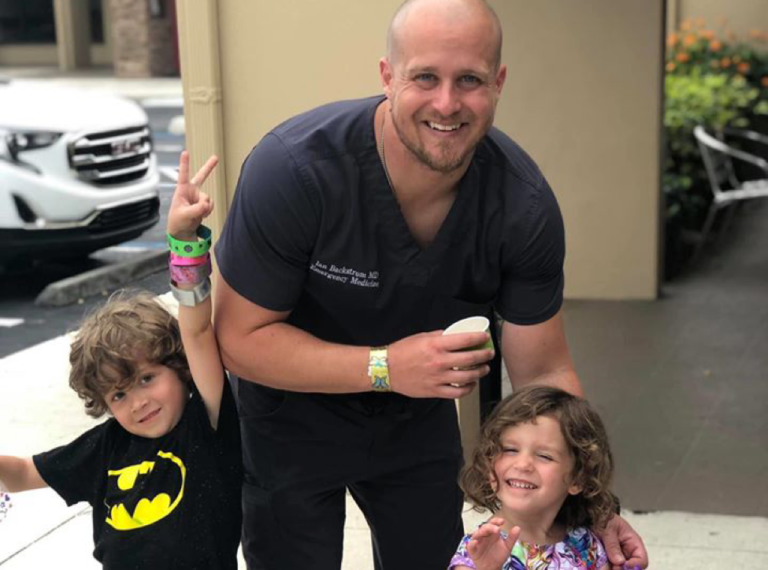 Doctor in scrubs with kids
