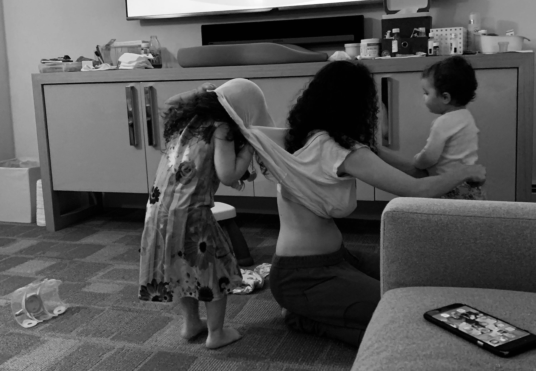 Black and white photo of mother with kids at home