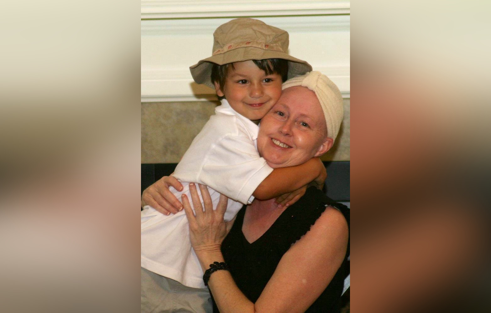 Woman with head scarf hugging child