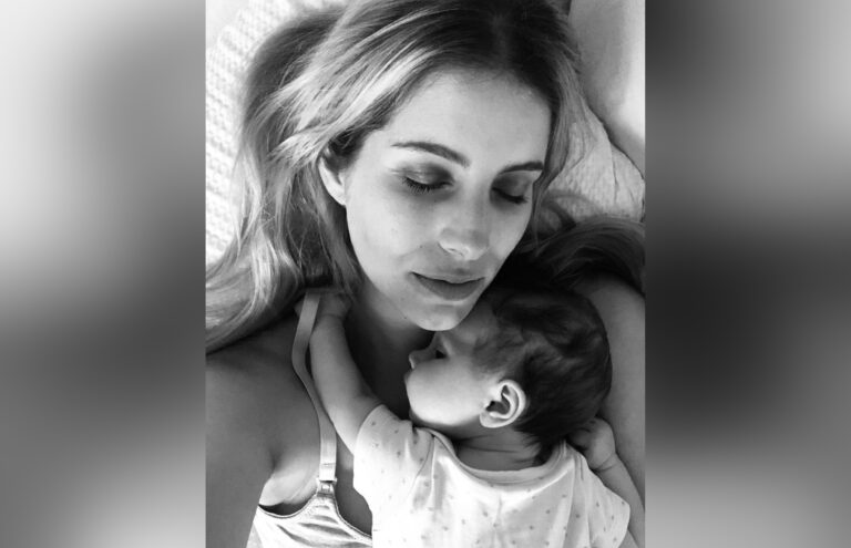 Mother holding newborn baby, black and white photo
