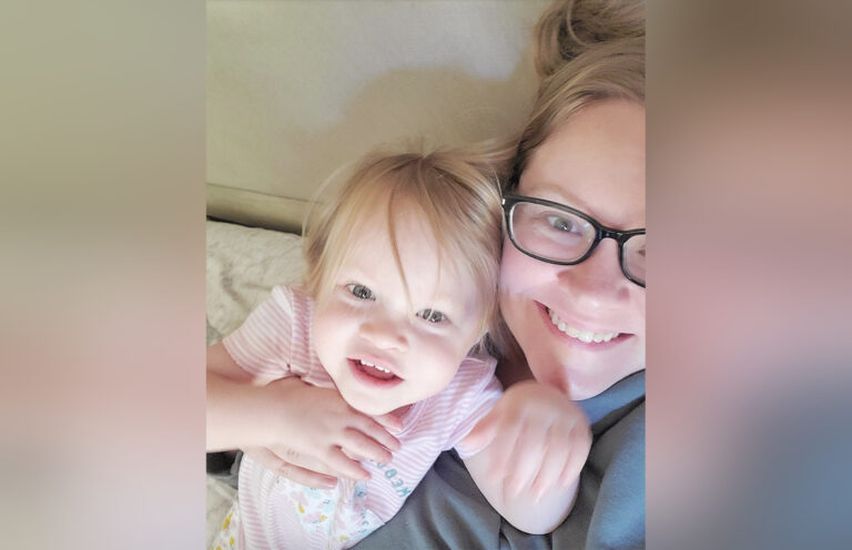 Mom and toddler girl smiling