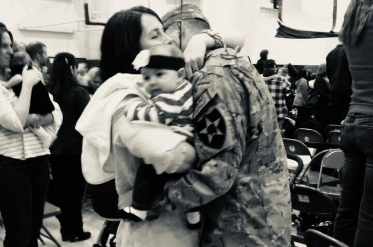 military family hugging
