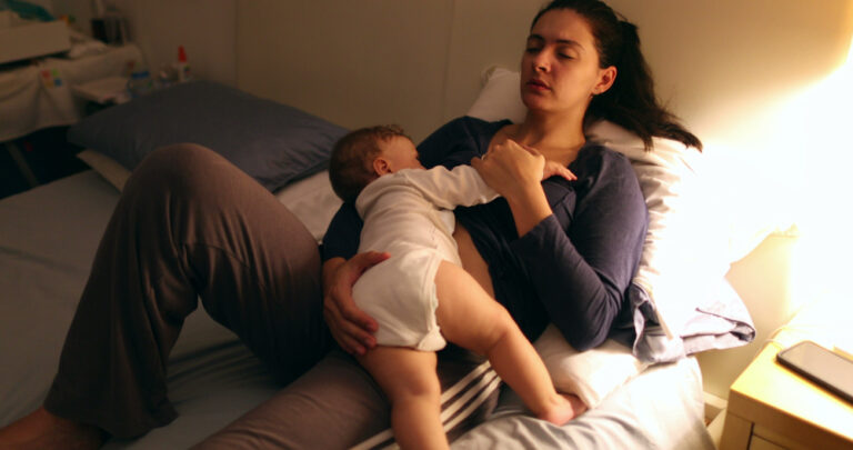 New mom nursing baby at home