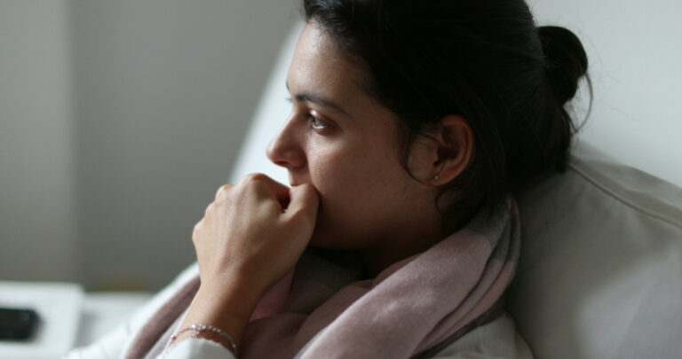 Tired woman biting nails