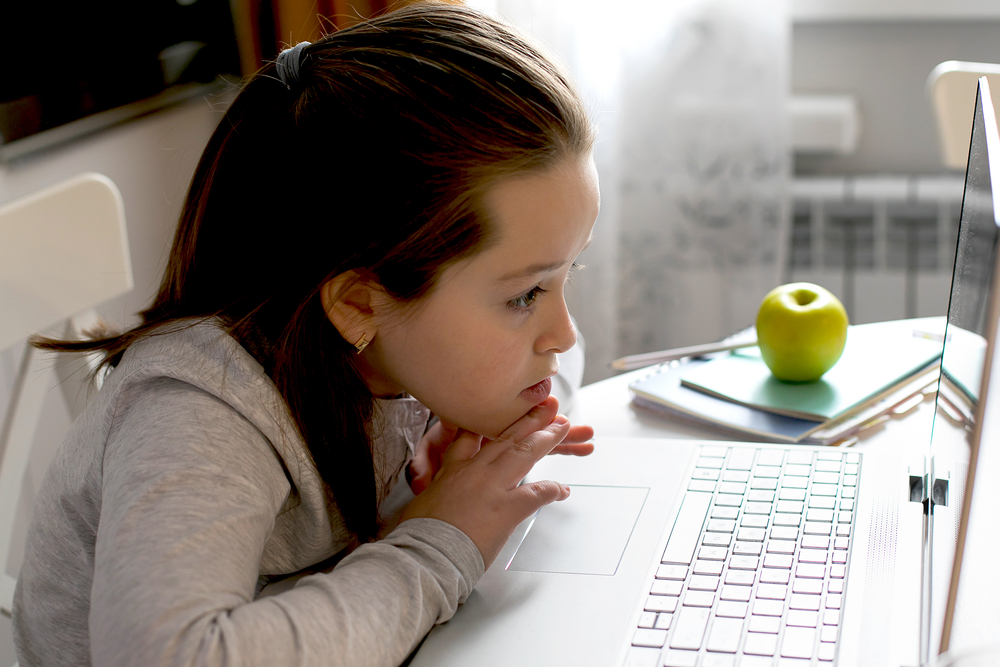 Girl distance learning online at home