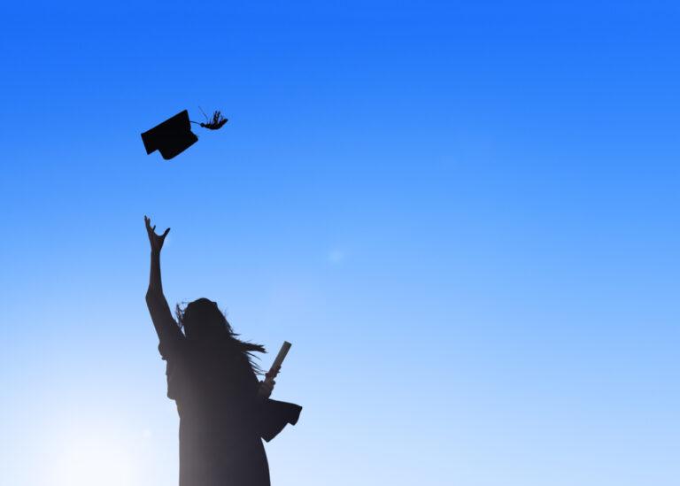 Silhouette of new grad tossing cap