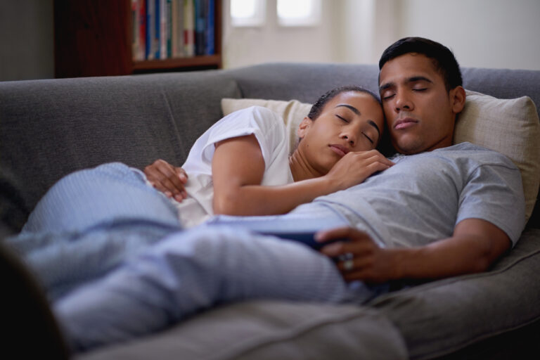 Man and woman at home on couch