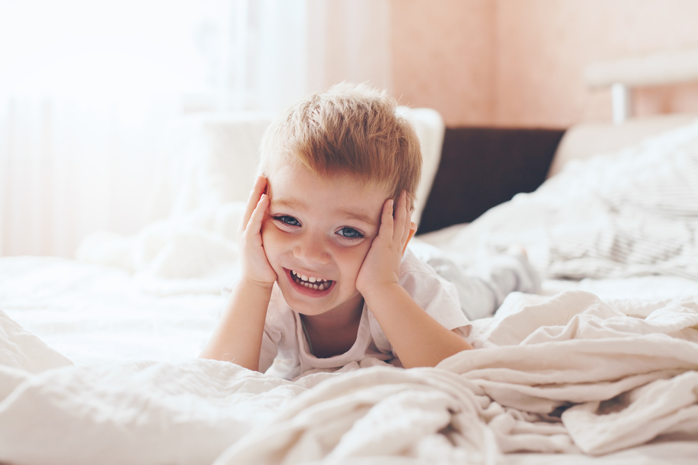 Little boy smiling at home