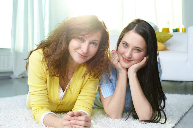 Teen daughter and mom smiling
