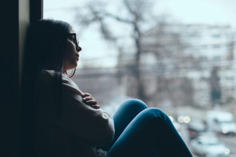 Sad woman in window