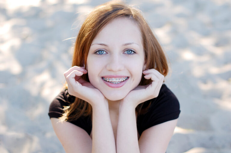 Teen girl wearing braces smiling