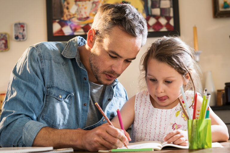Dad helping daughter with school at home