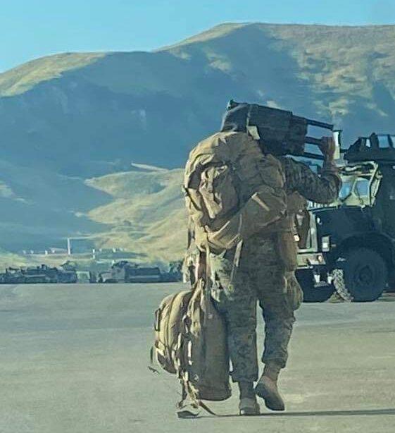 Military man walking away