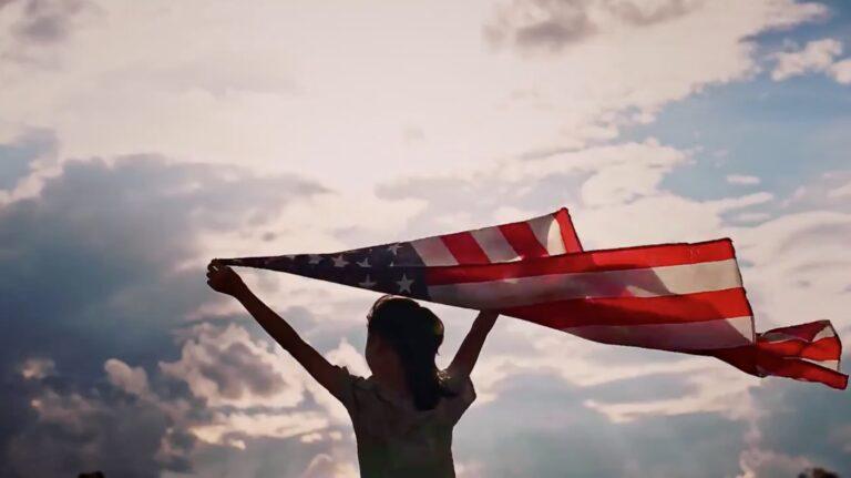 Girl holding waving flag