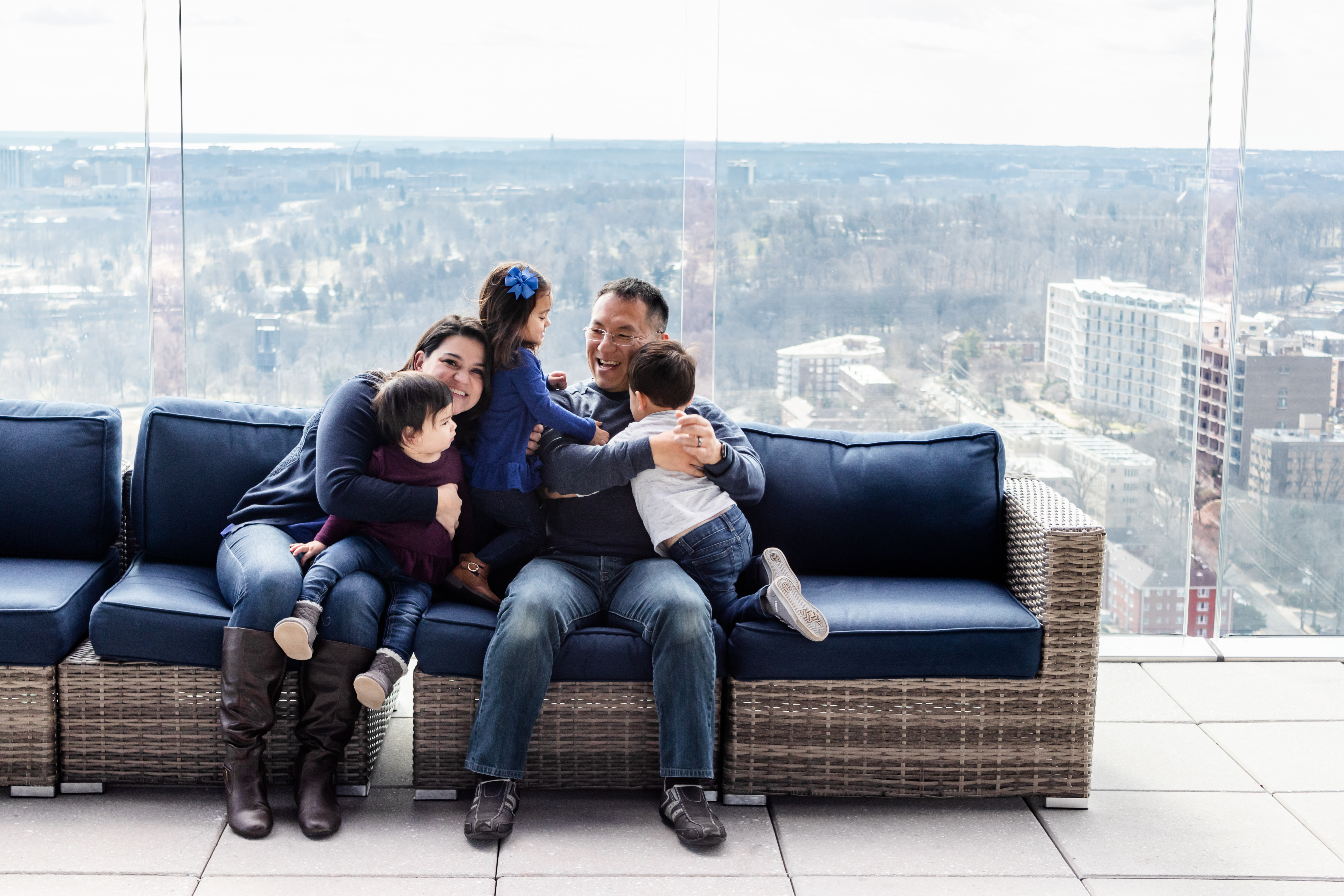Fun picture of family of five on couch, color photo
