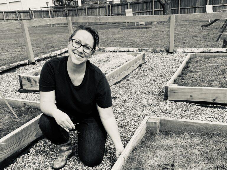 Woman in backyard garden