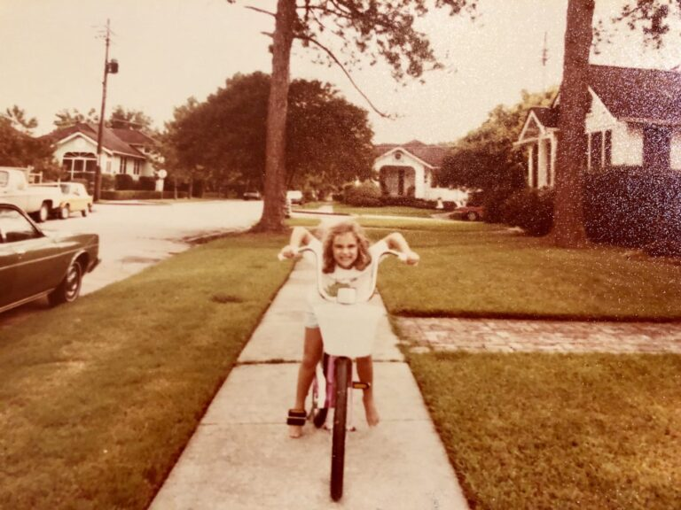 Little girl on bike retro photo