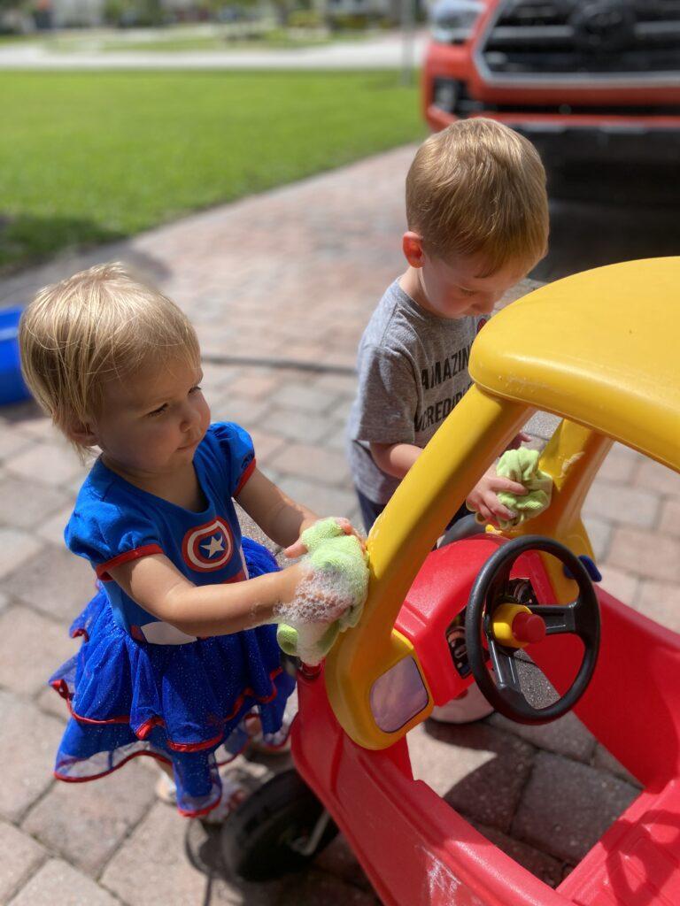 Kids washing toy car