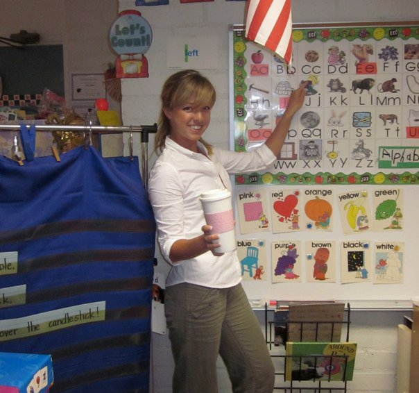 Teacher in elementary classroom, color photo