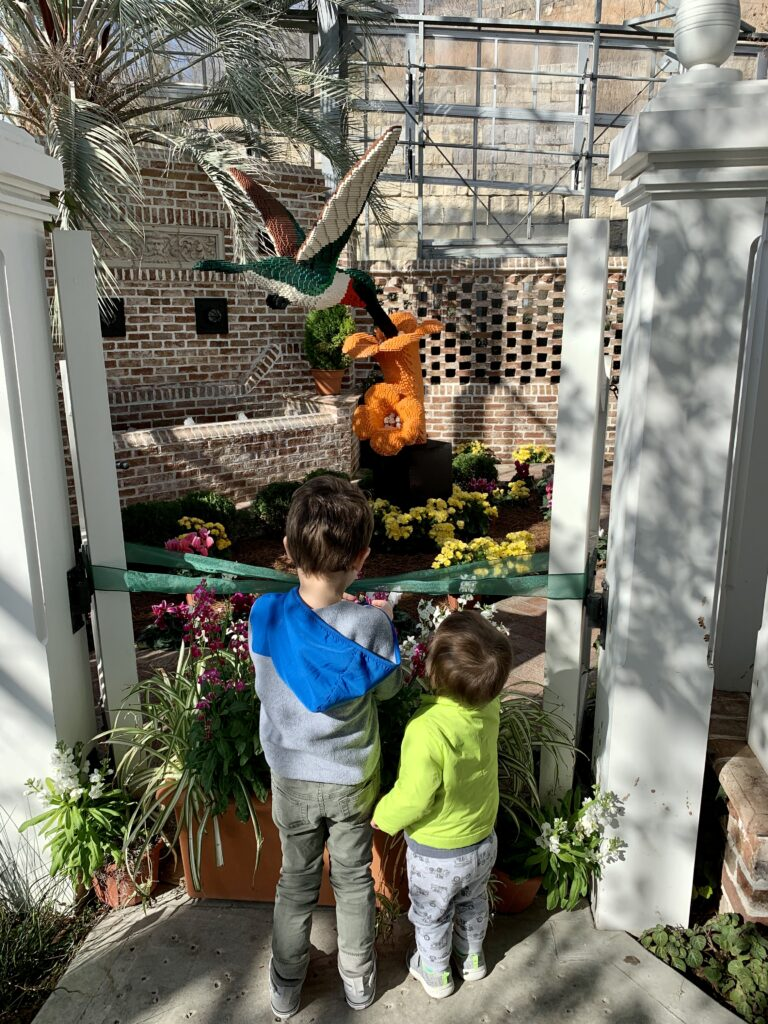 Two kids outside, color photo