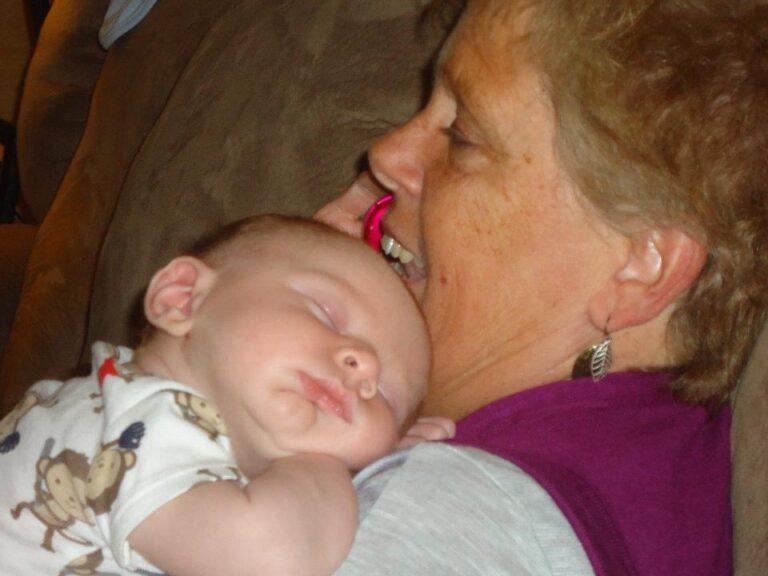 grandma holding sleeping baby