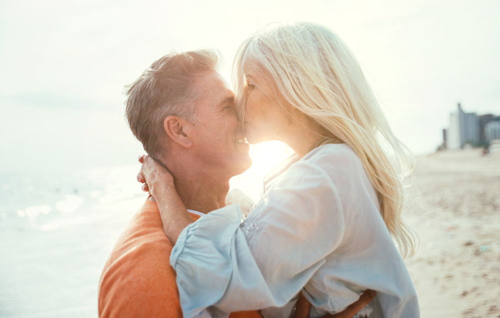 Woman kissing man on beach