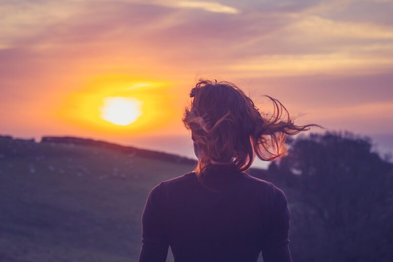 Woman walking in sunset