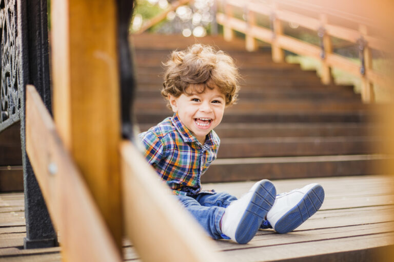 Little boy laughing outside