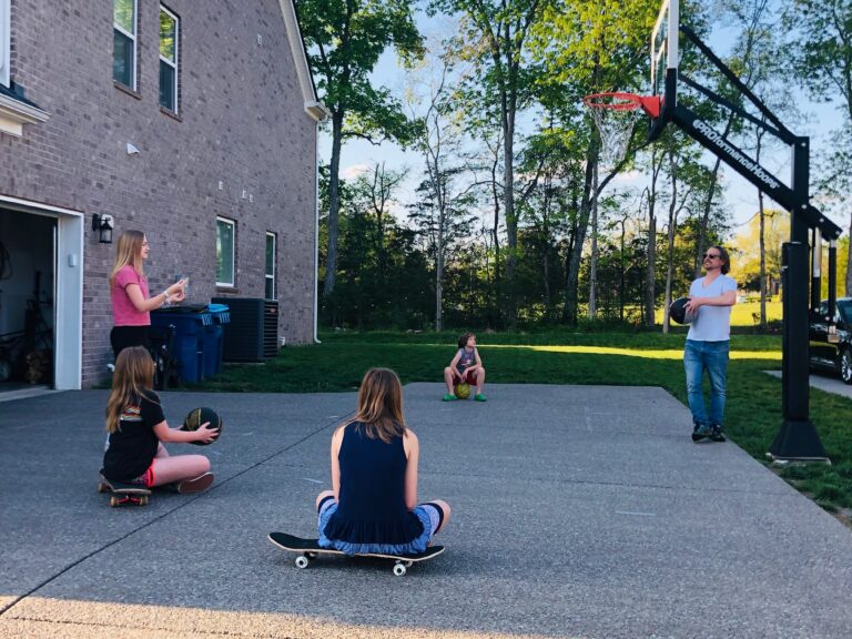 Family playing basketball outside