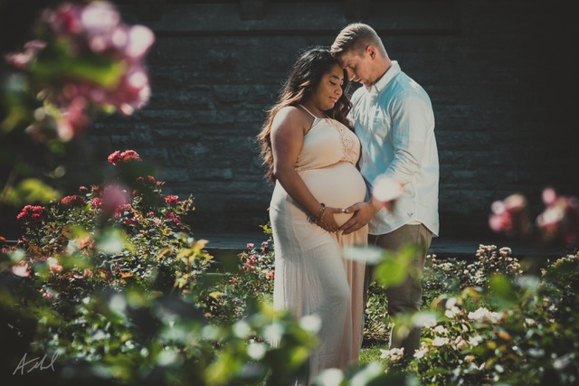 Man and pregnant woman embrace